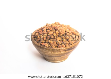 Photo of  Black Chick Pea or Kala Chana in wood bowl isolated on White Background, black chickpeas, Garbanzo beans, Chickpea (Channa), chickpeas (Begal Gram) in wood bowl