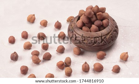 Photo of  Black Chickpeas or Kala Chana isolated on wooden Background.