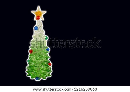 Black christmas background with a tree stock images. Simple Christmas card. Christmas decoration on a black background. Christmas tree with a star. Holiday background with copy space for text