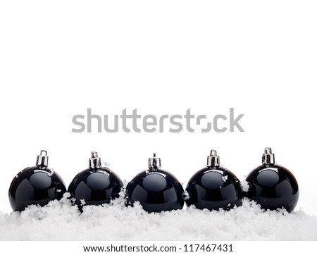 Black christmas balls with snow isolated on white background