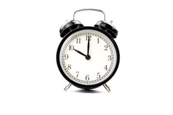 black classic alarm clock on a white background isolated