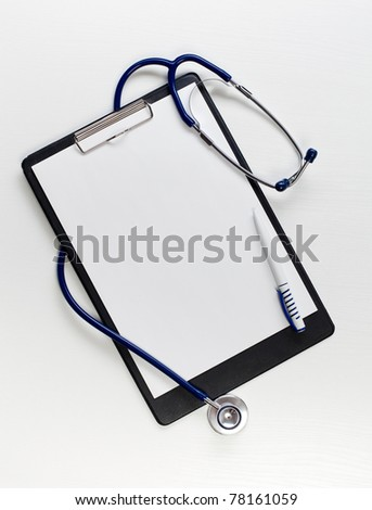 Black clipboard with  stethoscope. Medicine concept.
