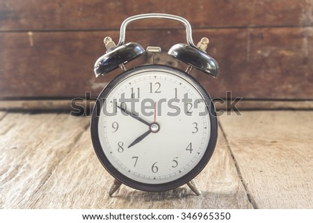 Black clock with wooden Instructions. #346965350