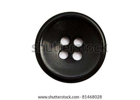 Black cloth button closeup on white background