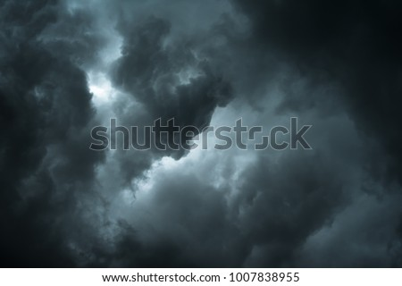 Black cloud and thunderstorm before rainy, Dramatic  black clouds and dark sky #1007838955