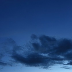 black cloud on blue night sky background