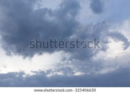 black cloud on blue sky, bad weather background #325406630