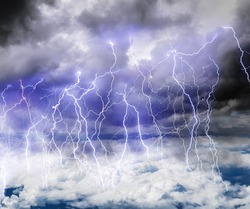 Black clouds in the sky full of lightning in a thunderstorm with a roll of Thunder