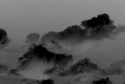 Black clouds on a dark background