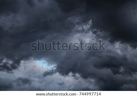 Black clouds on the day the thunderstorm. A piece of blue sky #744997714