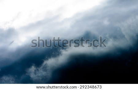 Black cloudy and dark sky before heavy rainy and storm coming soon