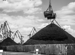 Black coal in the industrial port. Reload terminal.