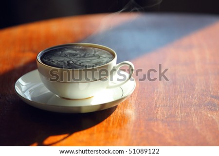 Black coffee. Cup of hot fragrant coffee on a table