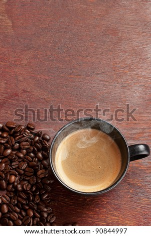 black coffee cup over grunge wooden table #90844997
