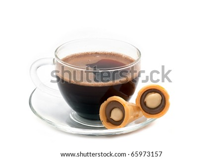 Black coffee in a glass with cookies isolated on white background