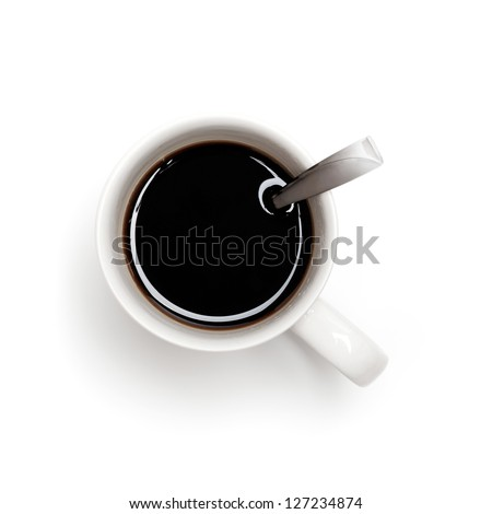 Black coffee in white cup with spoon, top view isolated on white