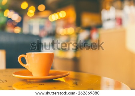 Black Coffee mug on wooden table in coffee shop - Vintage retro effect style pictures