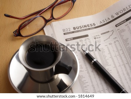 Black Coffee, Newspaper and Glasses on Desk