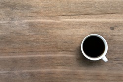 Black coffee on the wooden table.