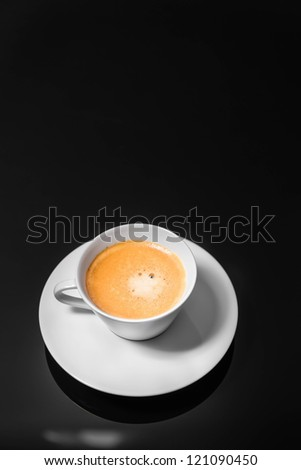 Black Coffee poured into stylish modern white coffee cup, selective focus, isolated background