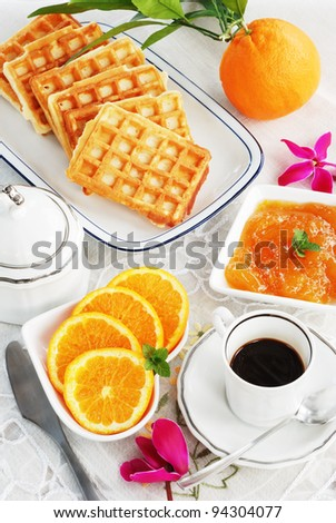 black coffee,waffles and orange marmalade on the table