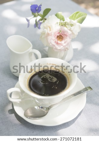 black coffee with flower, natural light
