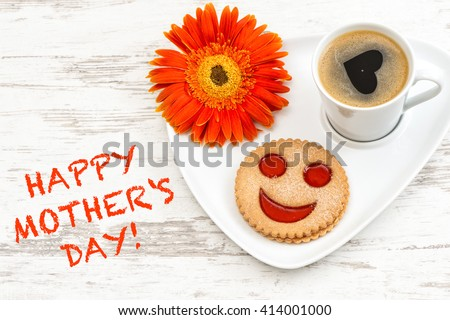 Black coffee with smiled cookie. Heart, love, flower. Happy Mothers Day! Mothers Day breakfast. Mothers Day greetings card. Mothers Day concept. Mother\'s Day. Mothers Day gift