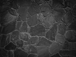 Black color decorative uneven cracked real stone wall surface with cement
