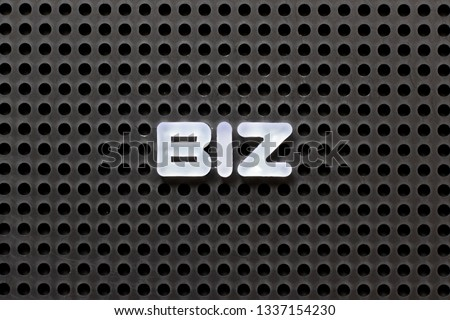 Black color pegboard with white letter in word biz (Abbreviation of business)