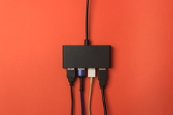 black color USB extension hub with four port on color background.