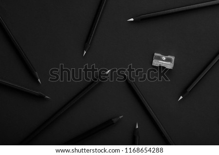 Black colored pencils on black background #1168654288