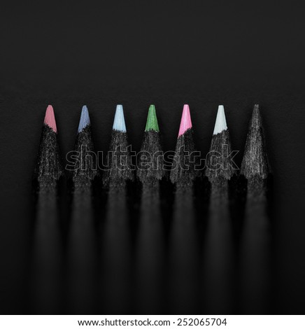 black, colored pencils, on black background, Shallow depth of field, pastel colors