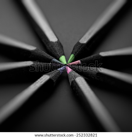 black, colored pencils on black background, Shallow depth of field, pastel colors