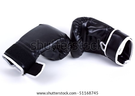 Black combat boxing leather gloves isolated on white