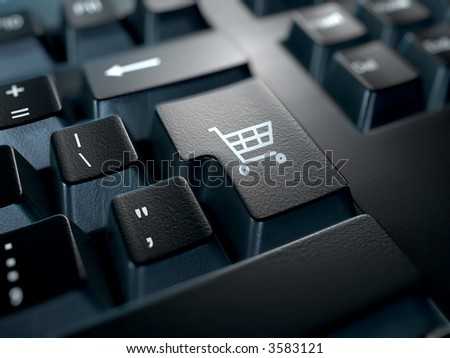 black computer keyboard with a shopping cart symbol on the return key
