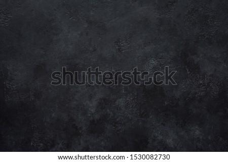 Black concrete wall background. Texture of black concrete