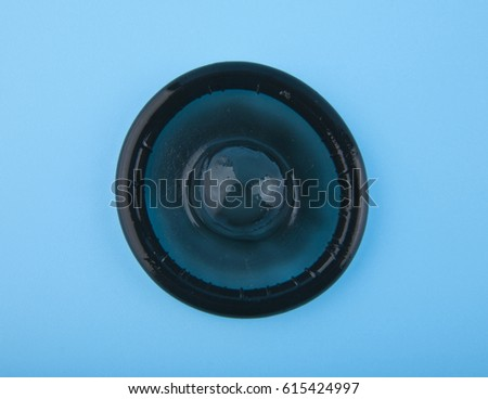 black condom on a blue background #615424997