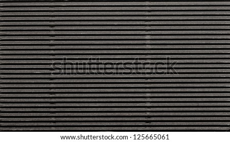 Black corrugated cardboard background.