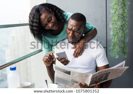 Black couple using mobile phone