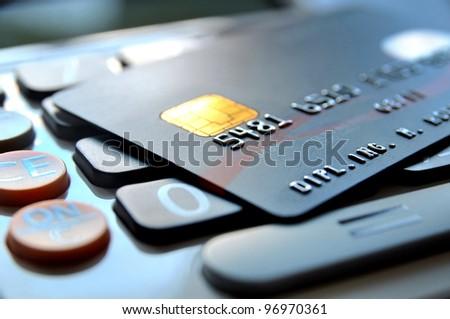 Black credit card on a calculator