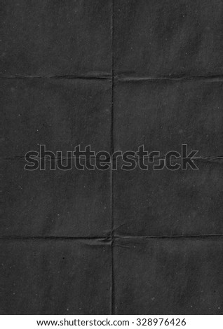 Black crumpled paper. Black abstract background