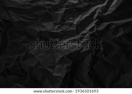 Black crumpled paper texture in low light background Stock photo ©