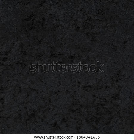 Photo of  Black crushed panne velvet fabric texture