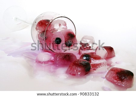 Black currant in pieces of ice.