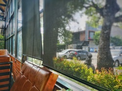 Black curtains behind glass in a classic coffee shop.