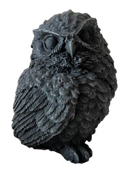 Black decorative owl figure made of clay isolated on white background. Symbol of science, wisdom, mind, mindfulness, thinking, clever, calm, silent, sight, seeing the hidden.