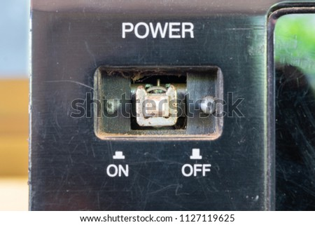 black Defective toggle switch on black surface on off #1127119625