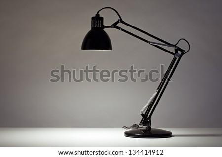 Black desk lamp isolated on white