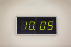 Black digital clock on a white background showing time 10.05