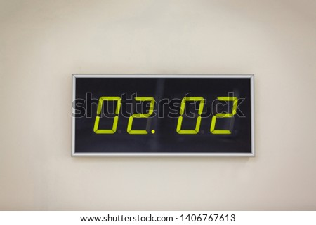 Black digital clock on a white background showing time 02.02 minutes
